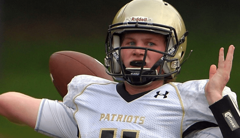 Rawlings tosses for four scores as John Carroll bounces back