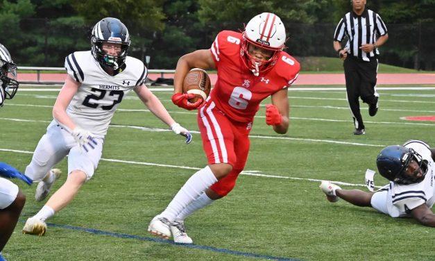 Spalding romps in football opener